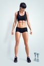 Fit female athlete in activewear ready to doing exercise with du dumbbells strong abs showing image clipping path Royalty Free Stock Image