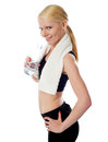 Fit female athlete holding a bottle of water Royalty Free Stock Photo