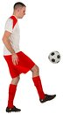 Fit football player playing with ball on white background Stock Image