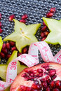 Fit fruits fresh pomegranate and carambola with tailor tape Royalty Free Stock Image