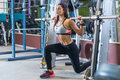Fit girl doing lunges with the smith machine Royalty Free Stock Photo