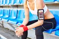Fit girl modern in activewear sitting at stadium Stock Photo