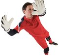 Fit goal keeper jumping up on white background Stock Photo