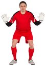 Fit goal keeper looking at camera on white background Stock Images