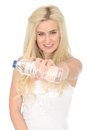 Fit Healthy Happy Young Blonde Woman Holding a Bottle of Mineral Water Royalty Free Stock Photo