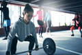 Fit healthy woman lifting a weight barbell Royalty Free Stock Photo