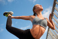 Fit lean blond beauty exercising outdoors in the city Royalty Free Stock Image