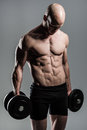 Fit male with dumbells a very athlete woth Royalty Free Stock Images