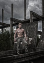 Fit male model muscled in a destroyed building Royalty Free Stock Images