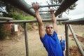 Fit man climbing monkey bars Royalty Free Stock Photo