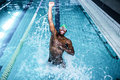 Fit man diving in the swimming pool at leisure centre Royalty Free Stock Image