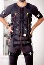 Fit man on  electro muscular stimulation machine Royalty Free Stock Photo