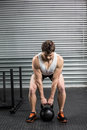 Fit man lifting dumbbells at crossfit gym Royalty Free Stock Photography