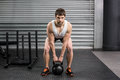 Fit man lifting dumbbells at crossfit gym Royalty Free Stock Images