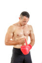 Fit man putting his boxing gloves preparing for training over w muscular white background Stock Photography