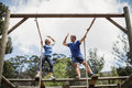 Fit man and woman giving high five during obstacle course Royalty Free Stock Photo
