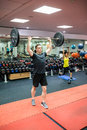 Fit man working out in weights room Royalty Free Stock Photo