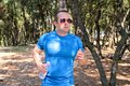 Fit muscular runner man jogging for fitness running at running trail in landscape nature outdoors. Royalty Free Stock Photo