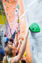 Fit people rock climbing indoors Royalty Free Stock Photo