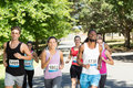 Fit people running race in park Royalty Free Stock Photo
