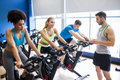 Fit people in a spin class at the gym Royalty Free Stock Photos