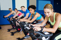 Fit people in a spin class at the gym Royalty Free Stock Images
