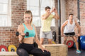 Fit people working out in gym Royalty Free Stock Photo