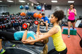 Fit people working out in weights room Royalty Free Stock Photo