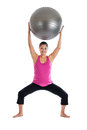Fit pregnant woman lifting exercise ball Royalty Free Stock Photo