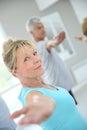 Fit Senior People Doing Yoga