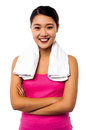Fit smiling woman with towel around her neck casual young chinese female model over white Stock Image