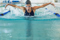 Fit swimmer doing the butterfly stroke in the swimming pool at leisure center Royalty Free Stock Photos