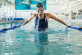 Fit swimmer doing the butterfly stroke in the swimming pool at leisure center Stock Image