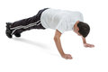 Fit teen boy doing pushups year old pushup exercises isolated on white background Stock Photo