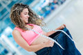 Fit woman in baggy pants weight loss concepts Royalty Free Stock Image