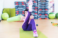 Fit woman doing abs workout exercise russian twists with raised leg Royalty Free Stock Photo