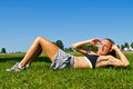 Fit woman doing sit ups as part of her exercise workout Royalty Free Stock Photos