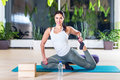Fit woman doing stretching pilates exercises in fitness studio. Royalty Free Stock Photo