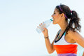 Fit woman drinking water from a bottle outdoors Stock Photo