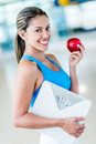 Fit woman eating healthy to lose weight Royalty Free Stock Photography