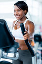 Fit woman exercising at the gym on an x trainer Royalty Free Stock Photos