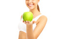 Fit woman giving green apple Royalty Free Stock Photo