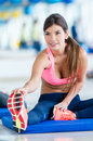 Fit woman at the gym beautiful exercising Stock Images
