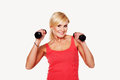 Fit woman lifting dumbbells Royalty Free Stock Photo