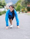 Fit woman ready to run in a position outdoors Stock Image