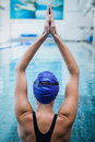 Fit woman stretching her arms in the water at pool Royalty Free Stock Images