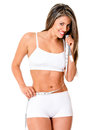 Fit woman with a tape measure Stock Images