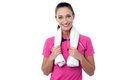Fit woman with towel around her neck young caucasian female trainer studio shot Royalty Free Stock Photography