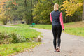 Fit woman walking in park Royalty Free Stock Photo