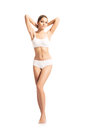 A fit woman in white lingerie on white young sporty and beautiful girl image isolated Royalty Free Stock Image